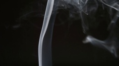 SLOW MOTION: Smoke lifts and dispels on a black background Stock Footage