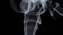 SLOW MOTION: Elegant smoke lifts up on a dark background Stock Footage
