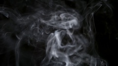 SLOW MOTION: Thin cigarette smoke on a black background Stock Footage