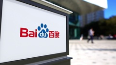 Street signage board with Baidu logo. Blurred office center and walking people Stock Footage
