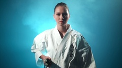 A karate woman with nunchuck isolated Stock Footage