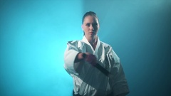 A karate woman fighting with nunchuck Stock Footage