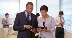 A team of professionals work on their project on their smart devices Stock Footage