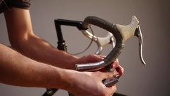 Man changing bar tape for road bike. Stock Footage