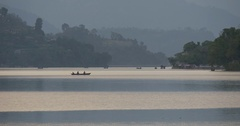 Many boats in lake swim in the distance Stock Footage