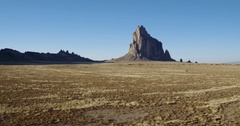 Approaching rock formation, Shiprock, New Mexico, United States Stock Footage