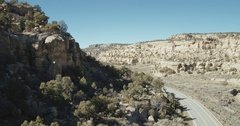 Barren rock outcropping near road, Tierra Amarilla, New Mexico, United States Stock Footage