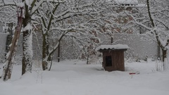 Snow falling on background of wooden kennel Stock Footage