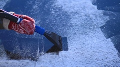 Scraping ice from car's front windshield window Stock Footage