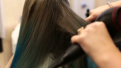 Woman gets her blue hair cut and styled Stock Footage