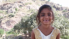 Portrait of lovely little Indian girl with missing teeth  Stock Footage