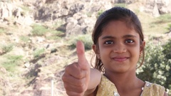 Thumbs up from a cute little Indian girl with missing teeth  Stock Footage