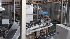 Plastic water bottles on conveyor or water bottling machine Stock Footage