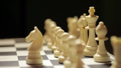 White horse captures black pawn Stock Footage