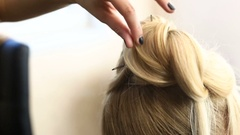 Woman gets her hair cut and styled Stock Footage