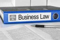 Blue folder with the label Business Law Stock Photos