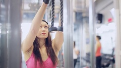 Muscular woman doing exercise on triceps in the gym Stock Footage