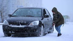 Woman shoveling and removing snow from her car Stock Footage