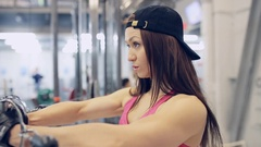 Muscular woman doing Cable Crossover Exercise in the gym Stock Footage