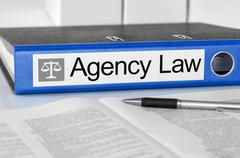 Blue folder with the label Agency Law Stock Photos