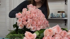 Florist arranging roses bouquet, flower shop Stock Footage