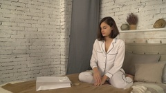 Female with package from shop in bedroom Stock Footage