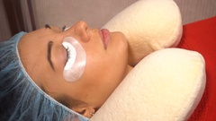Beautiful young woman doing eyelash extension Stock Footage