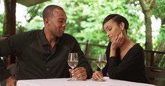 A black man and woman have wine Stock Footage