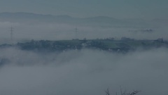 A german village surrounded by fog Stock Footage
