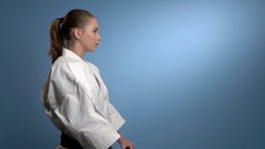 A karate woman fighting with nunchucks Stock Footage