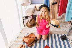 Happy fashion blogger showing headwear Stock Photos