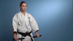 A karate woman fighting with nunchuck isolated Stock Footage