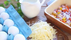 Preparation of omelet with ham and cheese before being baked. Stock Footage
