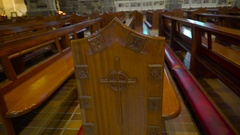 Long benches inside the church in Ireland in Ireland Stock Footage