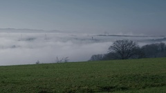 View from a hill on a foggy valley Stock Footage