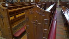 Long wooden benches inside the church in Ireland Stock Footage