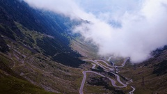 Spectacular view of winding road fast covered in mist. Stock Footage