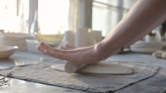 Hands of a woman working with clay in a ceramics workshop, slow motion Stock Footage