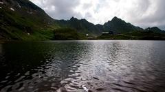Balea Lake a glacier lake situated at an altitude of 2034 m on Transfagarasan Stock Footage