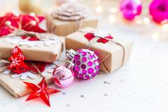 Christmas and New Year background with magenta purple decorative ball, pres.. Stock Photos