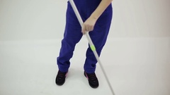 Woman builder sweeps the floor. Stock Footage