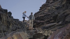 Rock Climbing Couple Carry Their Equipment, Walk Down Trail In Utah Mountains Stock Footage