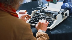 Vintage writer desk style, he is working and typing on his typewriter Stock Footage