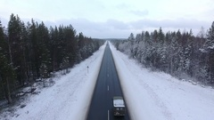 Small car driving next to vehicle on winter asphalt road. The Kola route, Russia Stock Footage