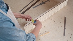 Carpenter with Tape Measurer Stock Footage