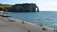 Local people and tourists on the beach in the town Etretat, Normandy, France Stock Footage
