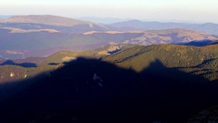 Mountain ridge shadow moving over mountains Stock Footage