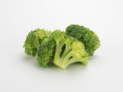 Broccoli Crowns on White Stock Photos