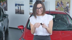 Young happy woman near the car with keys in hand - concept of buying car Stock Footage