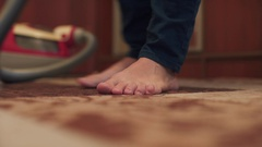 Woman cleaning the carpet with vacuum cleaner in the living room Stock Footage